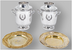 A pair of French silver wine-coolers and English silver-gilt dishes