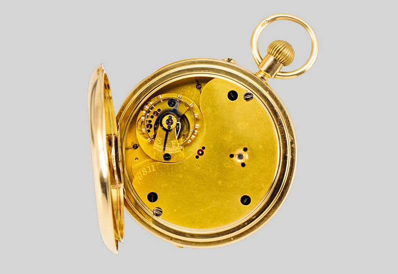 A gold Karussel lever watch